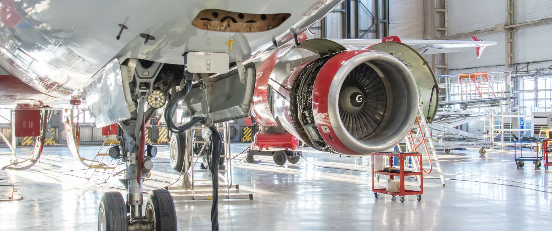 Commercial jet aircraft in hangar for maintenance